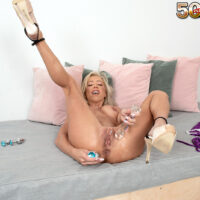 Experienced platinum blonde Mandy Monroe strips to high-heels while playing with sex toys