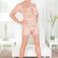 Top granny X-rated star Bea Cummins reveals her immense tits before touting her shaved cooch