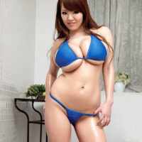 Oriental solo girl Hitomi sports lengthy crimson hair while whipping out her large tits from a swimsuit