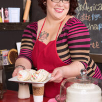 Ginger-haired BBW Kitty McPherson sports short hair and glasses while getting naked in a food joint