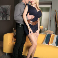 Giant boobed blonde Sandra Star is freed from a short dress before sex on a sofa