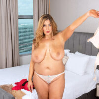 Plus sized stunner Gia Costello gobbles a nip after uncupping her hefty tits