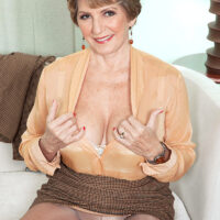 Solo GILF Bea Cummins parts her shaved twat after doffing business attire and glasses
