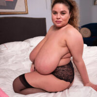 Amateur BBW Anna Katz discards her glasses prior to unveiling her large breasts