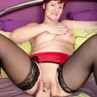 Redheaded grandmother Linda Storm does away with see-through lingerie during POV oral and vaginal sex