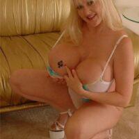 Mature platinum-blonde Kayla Kleevage finger parts her clean-shaved fuckbox after baring her gigantic boobies