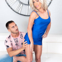 Blonde cougar Mandy Monroe seduces a junior guy in a short sundress and heels