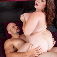 Redheaded fatty Harley Ann is liberated from a short dress before having sex with a hefty cock