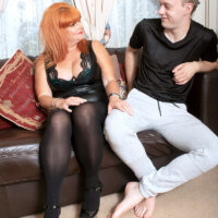 Redheaded cougar Melanie Taylor seduces a junior boy in a black leather dress