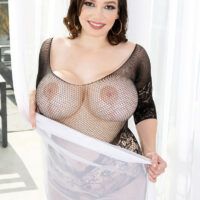 Solo female Brooklyn Springvalley releases her fake breasts while discarding a bodystocking
