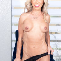 Enticing elderly blond Mandy Monroe strips to her pumps during her first nude shoot