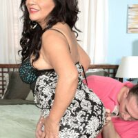 Black-haired MILF over fifty Victoria Versaci baring her enormous ass while being stripped raw
