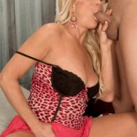 Spectacular yellow-haired grannie with superb legs Natasha entices and blows a junior ebony guy