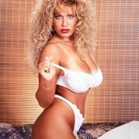 Notorious pornographic starlet Taylor Marie unleashes her big titties in a white sundress and lingerie