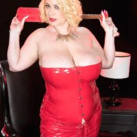 Light-haired fatty Samantha 38G frees her big tits from a crimson latex dress in high-heeled shoes
