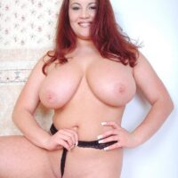 Redhead MILF Annie Swanson wets her immense boobs in the tub during solo action
