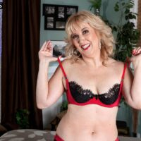 Aged wife with fair-hair Rebecca Williams seduces her husband in lingerie and pantyhose