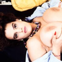 Solo model Nilli Willis holds her big boobs after loosing her furry pussy