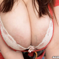 Solo chick Sofie Style frees her excellent breasts in the kitchen before showing her coochie