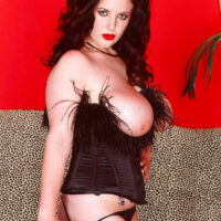 Hefty titted solo female Angela White tongues a nip prior to toying her smooth-shaven cootchie