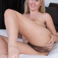 Lingerie outfitted yellow-haired amateur Aali Rousseau sliding bloomers aside to reveal her snatch