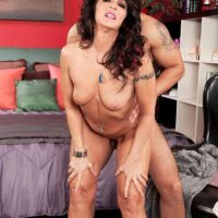 Over fifty brunette Azure Dee jerks a junior stud's dick before doggie-style fucking begins