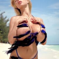 Well-known sandy-haired XXX actress Tiffany Towers displaying her funbags while at the beach