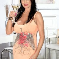 Top mature pornstar Rita Daniels unveils her immense breasts and showcases her panties too