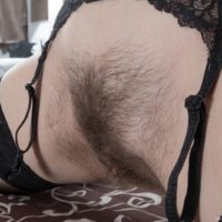 dark-haired amateur Dea Ishtar parting her furry cooter in nylons and high-heels