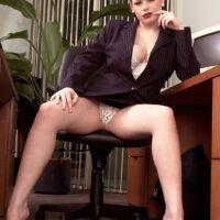Euro MILF XXX pornstar Desirae flashing hefty upskirt booty in a work environment while attired in high heels