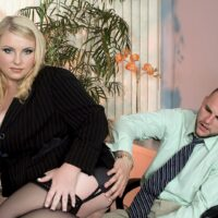 Light-haired fatty Scarlett Rouge seduces a dude for sex on her office place desk