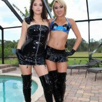 Enticing dolls Daisy Haze and Marina Angel tease a male submissive that sports a virginity implement