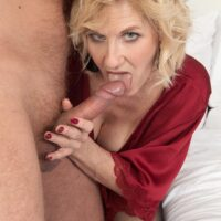 Sandy-haired cougar Molly Maracas blows her younger lover's cock after he brings her some bubbly
