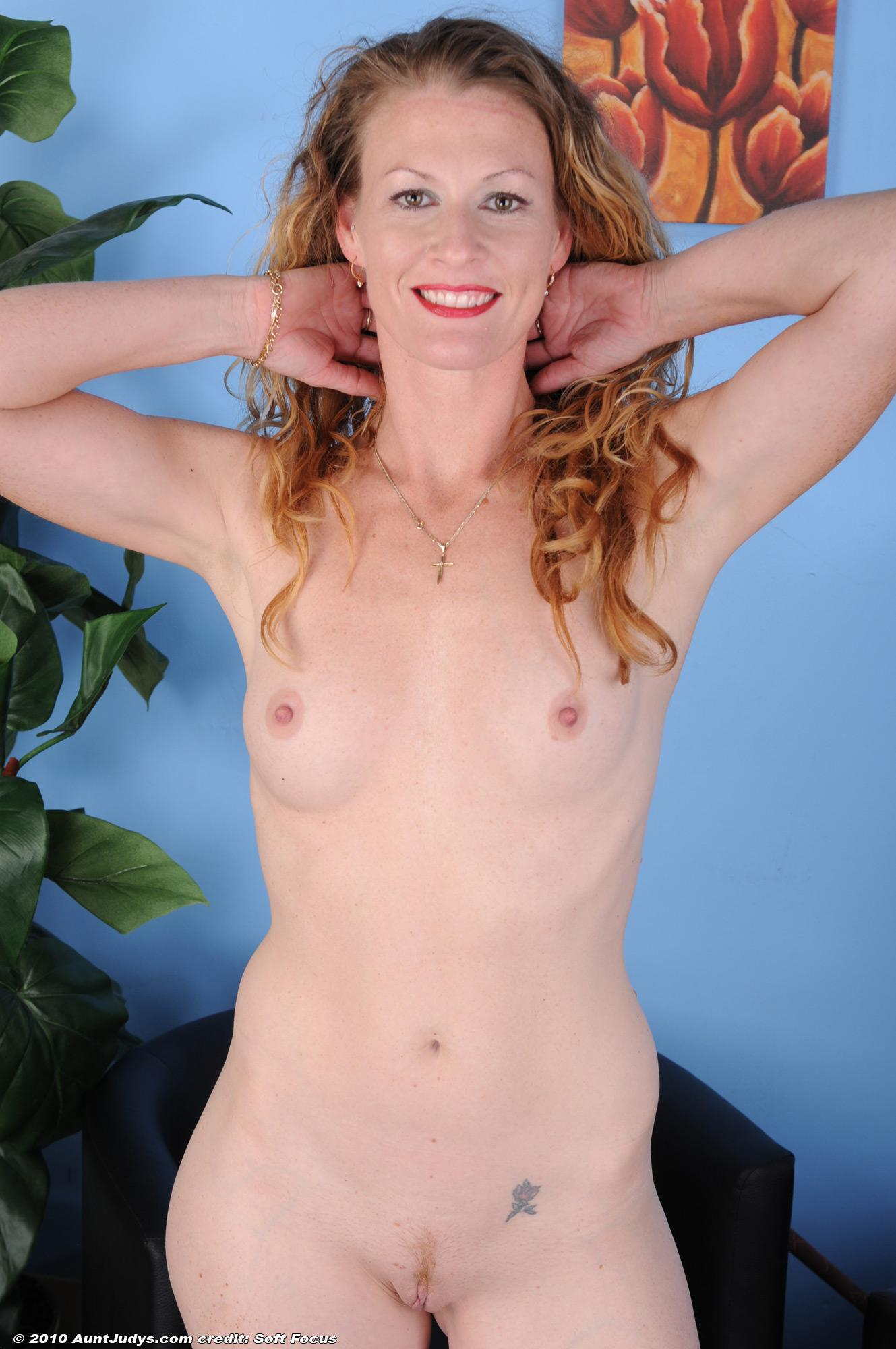 Accomplished blonde housewife sports red lips while undressing for her first nude gig