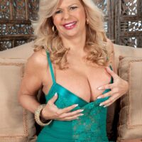 Expert sandy-haired doll Miss Deb looses her giant tits from her lingerie on a chesterfield