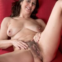 First-timer Kaysy displays her natural snatch after getting downright naked