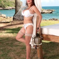 MILF XXX actress Valory Irene models out on an oceanside lawn in her undies