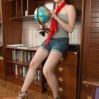 Short haired first timer in high-heeled shoes Aria peeling off cut-offs to uncover furry snatch