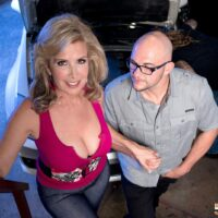 Big-titted ash-blonde cougar Laura Layne seducing mechanics for an MMF threesome in a garage