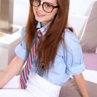 Glasses clad coed Alice Green looses her puny teener titties while wearing panties