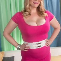 Bodacious fair-haired stunner Cameron Skye looses her immense hooters from a dress to be lubricated