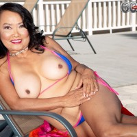 Sixty Plus Chinese MILF Mandy Thai takes off a rope bathing suit to get nude by a pool