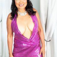 Sixty Plus Japanese MILF Mandy Thai wears no brassiere under her sundress while seducing a man