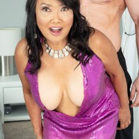 Sixty Plus Japanese MILF Mandy Thai wears no brassiere under her sundress while seducing a man