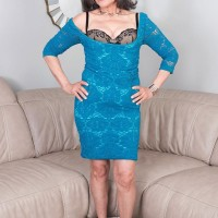 60 plus grandmother Kokie Del Coco seduces a junior stud in a short sundress on the chesterfield