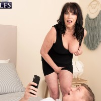 Sixty plus MILF Christina Starr tempts a youthful man while going bra-less in a black sundress