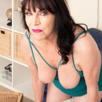 60 plus MILF Christina Starr unveils her sagging titties as she gets downright naked
