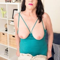 Sixty plus MILF Christina Starr uncovers her sagging boobies as she gets fully nude