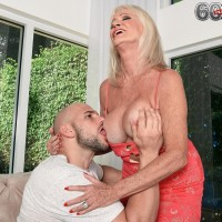 Sixty plus MILF Leah L'Amour seduces a younger man at the door with her humungous tits out