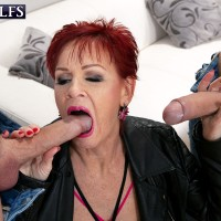 60 plus redhead Caroline Hamsel tempts a couple of dudes on the street in slutwear